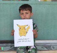 Suriyeli Çocuklar Dünyanın Dikkatini Çekme Ümidiyle Pokemonlarla Poz Veriyor